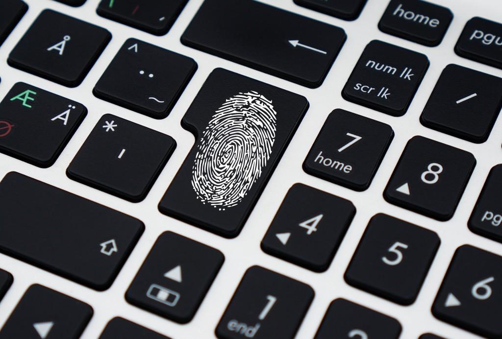 File Sharing Security & IT Recruitment fingerprint on keyboard